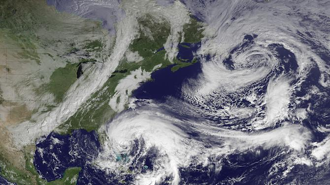 """In this image taken by NOAA's GOES East at 2:45 GMT on Friday, Oct. 26, 2012, Hurricane Sandy is seen in the center bottom. The hurricane has killed at least 20 people in the Caribbean, and just left the Bahamas. It is expected to move north, just off the Eastern Seaboard. When Hurricane Sandy becomes a hybrid weather monster some call """"Frankenstorm"""" it will smack the East Coast harder and wider than last year's damaging Irene, forecasters said Friday. (AP Photo/NOAA)"""