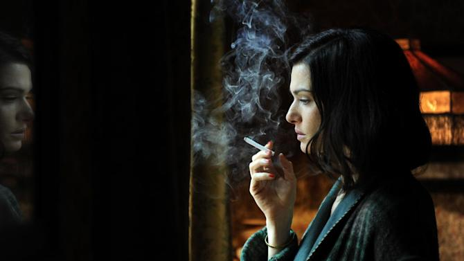 """In this film image released by Music Box Films, Rachel Weisz portrays Hester Collyer in a scene from """"The Deep Blue Sea.""""  Weisz was nominated Thursday, Dec. 13, 2012 for a Golden Globe for best actress in a drama for her role in the film.  The 70th annual Golden Globe Awards will be held on Jan. 13.  (AP Photo/Music Box Films)"""