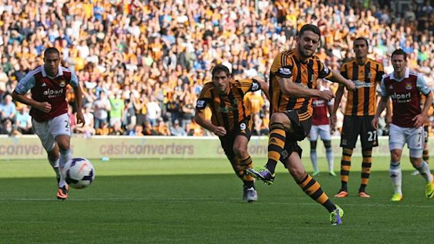 Robbie Brady scores the winning penalty for Hull against West Ham