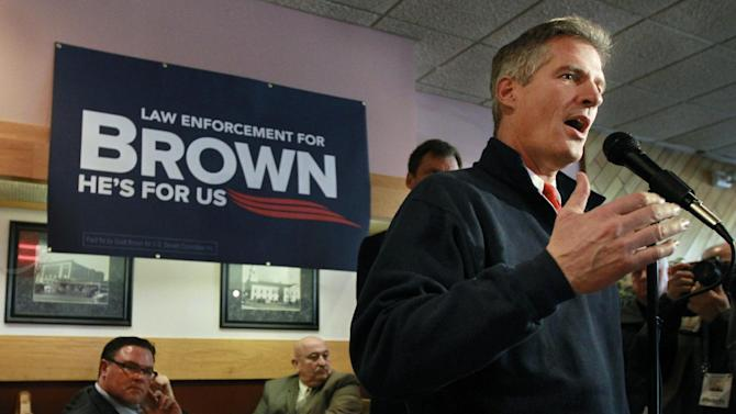 U.S. Sen. Scott Brown, R-Mass., right, addresses an audience during a campaign event at a restaurant, in Milford, Mass., Thursday, Nov. 1, 2012.  Brown and Democratic challenger Elizabeth Warren have already spent nearly $68 million pursuing the same U.S. Senate seat, shattering all previous spending records in Massachusetts. (AP Photo/Steven Senne)