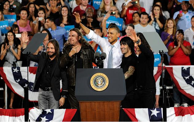 President Barack Obama, center, appears with the musical group Mana at campaign event at Desert Pines High School on Sunday, Sept. 30, 2012 in Las Vegas. Obama is spending three days in Henderson, Nev