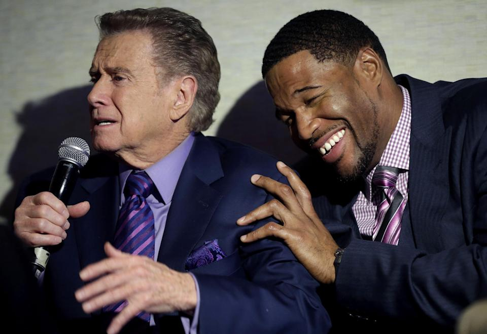 Regis Philbin, left, jokes with Michael Strahan during a news conference about the new Fox sports network in New York, Tuesday, March 5, 2013. Philbin will host a weekday sports talk show for the network's new channel Fox Sports 1. (AP Photo/Seth Wenig)
