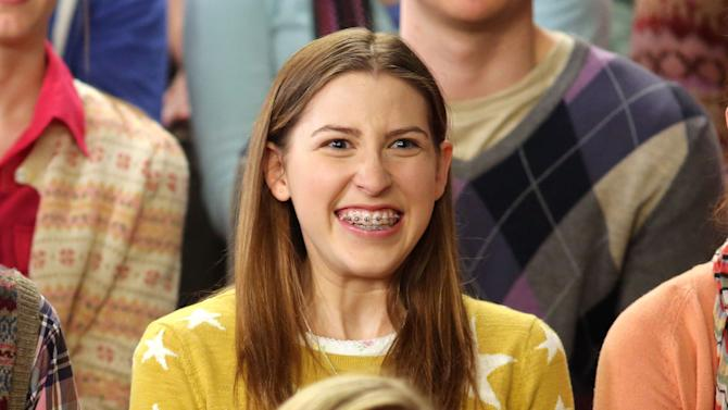 """This undated publicity image released by ABC shows actress Eden Sher as Sue Heck in a scene from the comedy series """"The Middle,"""" airing Wednesday at 8 p.m. EST on ABC. Sher wore a set of removable braces to her audition to play the daughter on the ABC comedy, helping her win the job. They're the signature of the geeky, loveable loser that is high school soph Sue Heck. (AP Photo/ABC, Michael Ansell)"""