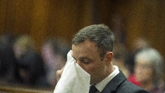 Oscar Pistorius sits in court for the last day of sentencing procedures where the defense and prosecution will put their case for and against sentencing, in Pretoria, South Africa, Friday, Oct. 17, 2014. Pistorius was found guilty last month of culpable homicide in the shooting death of his girlfriend Reeva Steenkamp  on Valentine's Day in 2013. (AP Photo/Mujahid Safodien, Pool)