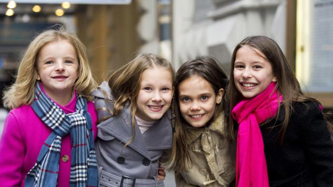 "Actresses from left, Milly Shapiro, Sophia Gennusa, Oona Laurence and Bailey Ryon, who will share the title role in ""Matilda the Musical"" on Broadway, pose for a portrait outside the Shubert Theatre, on Thursday, Nov. 15, 2012 in New York. (Photo by Charles Sykes/Invision/AP)"