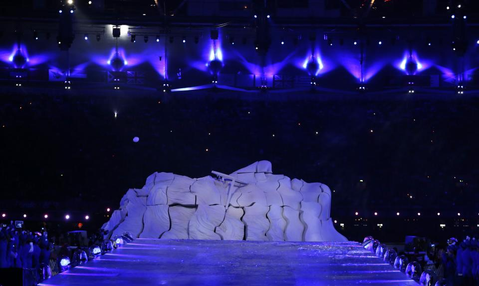 A sculpture in the shape of late Beatles band member John Lennon is seen during the Closing Ceremony at the 2012 Summer Olympics, Sunday, Aug. 12, 2012, in London. (AP Photo/Matt Dunham)