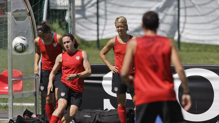 United States' Heather O'Reilly, left, passes to Abby Wambach , right, during a training session in preparation for a quarterfinal match against Brazil during the Women's Soccer World Cup in Dresden, Germany, Saturday, July 9, 2011. (AP Photo/Marcio Jose Sanchez)