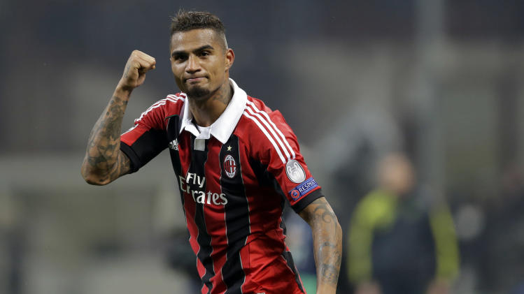 AC Milan midfielder Kevin Prince Boateng, of Ghana, celebrates at the end of the Champions League round of 16, first leg soccer match against Barcelona, at the San Siro stadium in Milan, Italy, Wednesday, Feb. 20, 2013. AC Milan won 2-0. (AP Photo/Luca Bruno)