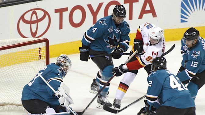 Calgary Flames' Sam Bennett shoots as San Jose Sharks goalie Martin Jones defends during the third period of an NHL hockey game, Saturday, Nov. 28, 2015, in San Jose, Calif. (AP Photo/George Nikitin)