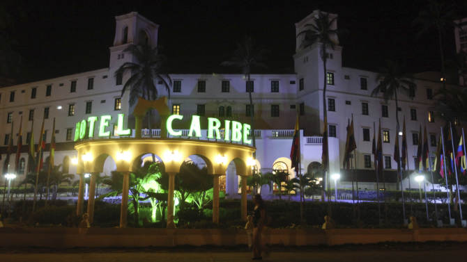 FILE - In this April 19, 2012, file photo, people walk past Hotel El Caribe in Cartagena, Colombia.  Seven Army soldiers and two Marines have received administrative punishments, but are not facing criminal charges, for their part in the Secret Service prostitution scandal in Colombia this year, The Associated Press has learned. U.S. officials said that one Air Force member has been reprimanded but cleared of any violations of the Military Code of Justice. And final decisions are pending on two Navy sailors, whose cases remain under legal review. (AP Photo/Pedro Mendoza, File)