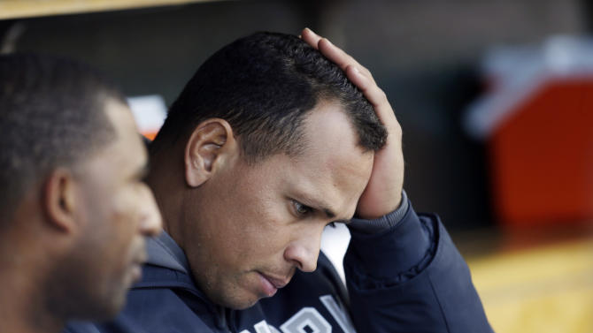 FILE - In this Oct. 18, 2012, file photo, New York Yankees' Alex Rodriguez watches from the dugout during Game 4 of the American League championship series against the Detroit Tigers in Detroit. Injuries have kept him off the field for more than half the season and now A-Rod faces discipline from Major League Baseball in its drug investigation, possibly up to a lifetime ban.(AP Photo/Paul Sancya, File)