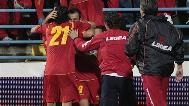 Montenegro&#39;s players celebrate (Reuters)