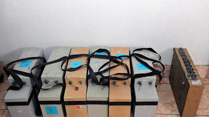 In this photo released by the Syrian official news agency SANA, devices that were found in country's coastal region, northwest of Damascus, Syria, Thursday, March 7, 2013. Syria's state-run media said were placed by Israel to spy on Syria. SANA's report says the devices are designed to photograph, register and transfer data. Syria and Israel are at a state of war and fought several battles over the past. (AP Photo/SANA)