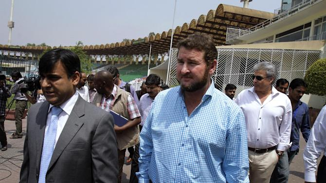 Alistair Campbell, center, managing director of Zimbabwe Cricket arrives with Pakistan Cricket Board officials at Gaddafi Stadium to evaluate security arrangements for the upcoming cricket series, Wednesday, May 6, 2015 in Lahore, Pakistan.  Campbell says his country's tour of Pakistan could help the sport return to the country. International cricket in Pakistan has been suspended for the last six years because of security concerns of foreign teams. (AP Photo/K.M. Chaudary)