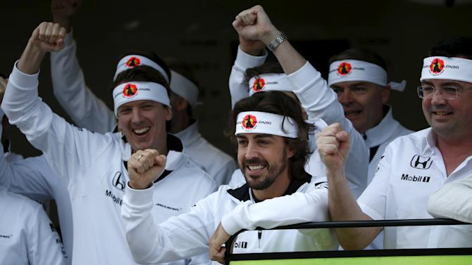 McLaren Formula One driver Alonso of Spain poses for a team photo in Sochi