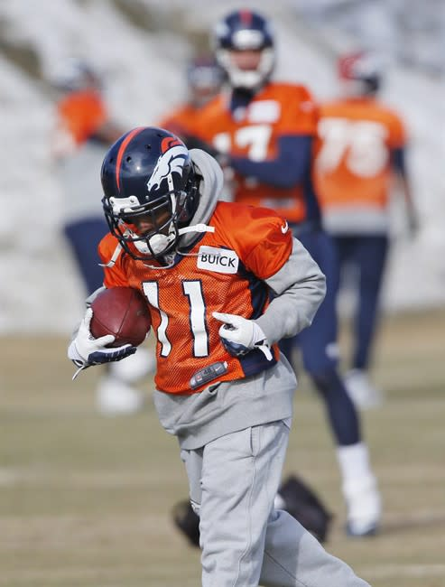 Denver Broncos wide receiver Trindon Holliday (11) pulls in a pass during practice for the football team's NFL playoff game against the San Diego Chargers at the Broncos training facility in Engle