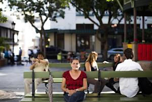 A woman sits on a bench on November 14, 2013 in San…