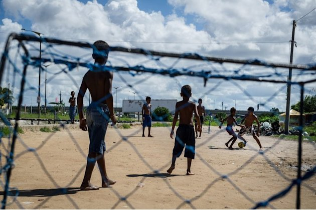 Boys play football in the shantytown of Olinda, about 18 km from Recife in northeastern Brazil, on June 18, 2013