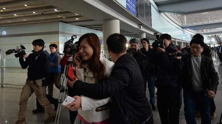 A woman cries at Beijing Airport