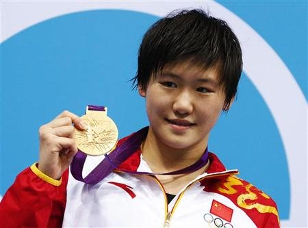 China's Ye Shiwen poses with her gold medal after winning the women's 200m individual medley final during the London 2012 Olympic Games at the Aquatics Centre July 31, 2012. 