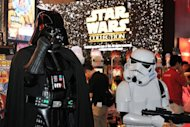 Darth Vader and Storm Troopers pose for visitors at the annual Tokyo Game Show in September. The Star Wars series, piloted by US filmmaker George Lucas, has captivated audiences worldwide with its pulp storytelling, complex mythology and innovative special effects
