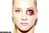 Closeup of Heather Morris with a painted-on black eye
