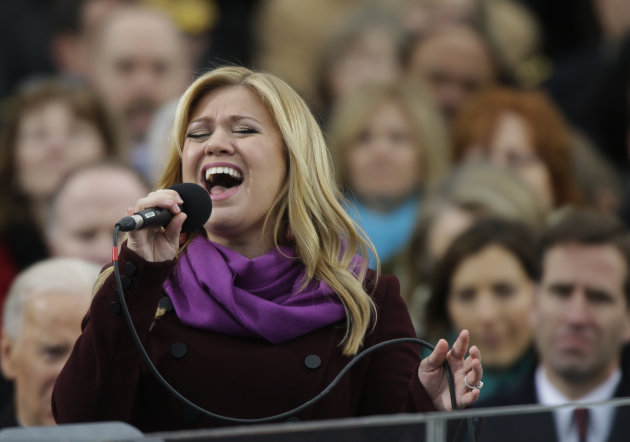 Singer Kelly Clarkson performs at the ceremonial swearing-in for President Barack Obama at the U.S. Capitol during the 57th Presidential Inauguration in Washington, Monday, Jan. 21, 2013. (AP Photo/Pa