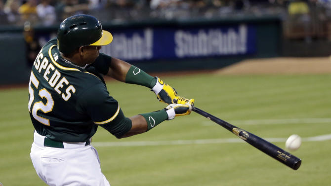Cespedes hits 2 HRs, A's hold off Astros 9-7