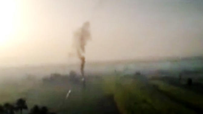 In this Tuesday, Feb. 26, 2013, image taken from video obtained from Al Jazeera, which has been authenticated based on its contents and other AP reporting, smoke rises from a hot air balloon after it burst in a flash of flame and then plummeted about 1,000 feet to earth carrying sightseers on a sunrise flight over the ancient city of Luxor, 510 kilometers (320 miles) south of Cairo, Egypt. Nineteen people were killed on Tuesday, Feb. 26, 2013 in what appeared to be the deadliest hot air ballooning accident on record. The balloon was carrying 20 tourists from France, Britain, Belgium, Japan,  Hong Kong, and an Egyptian pilot. (AP Photo/ Al Jazeera via AP video)