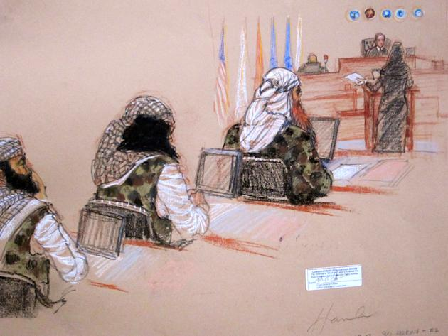 In this pool photo of a sketch by courtroom artist Janet Hamlin and reviewed by the U.S. Department of Defense, three of the five Sept. 11 defendants, from left, Ramzi Binalshibh, Walid bin Attash and