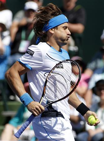 David Ferrer of Spain reacts after losing a point against Kevin Anderson of South Africa during their match at the BNP Paribas Open ATP tennis tournament in Indian Wells, California
