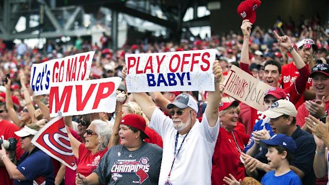 Washington Nationals fans celebrate after their team won 5-1 in a baseball game against the Philadelphia Phillies in Washington, Wednesday, Oct. 3, 2012.  (AP Photo/Manuel Balce Ceneta)