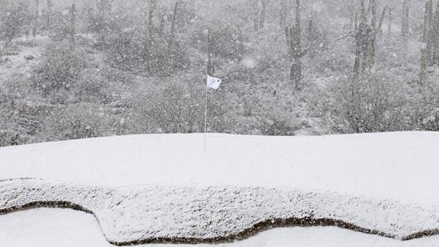 The 18th green is covered in snow as play was suspended during the first round of the WGC-Accenture Match Play Championship golf tournament in Marana, Arizona February 20, 2013.