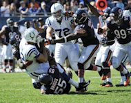 Henry Melton #69 of the Chicago Bears and Lance Briggs #55 sack Andrew Luck #12 of the Indianapolis Colts on September 9, 2012 during their 2012 NFL season opener in Chicago, Illinois. The Chicago Bears defeated the Indianapolis Colts 41-21
