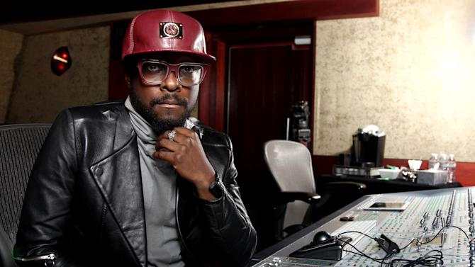 "In this April 24, 2013 photo, will.i.am poses for a portrait in Los Angeles. Will.i.am says he's been unfairly accused of stealing a song from a Russian dance producer.  The producer-rapper-singer has acknowledged reaching out to trance producer Arty after hearing his 2011 song with London's Mat Zo, ""Rebound."" Will.i.am recorded a new version with Chris Brown titled ""Let's Go.""  Will.i.am credits Arty as a writer on the song in the liner notes for his album, ""#willpower,"" released this week. He blamed the slow legal clearance process his legal team was also at work on the issue. (Photo by Matt Sayles/Invision/AP)"