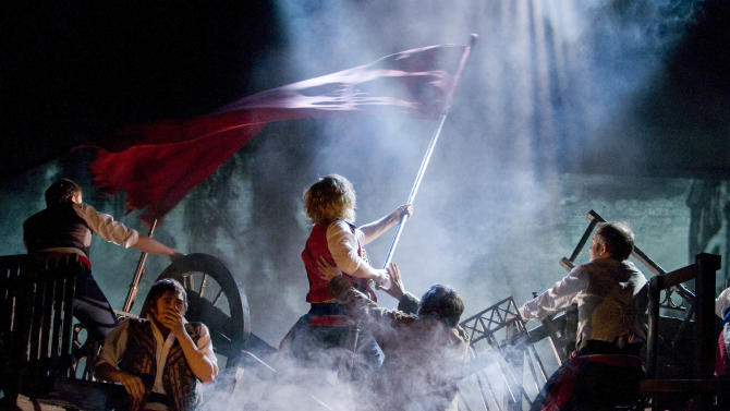 """This undated theater image released by The Publicity Office shows a scene from the musical """"Les Miserables."""" The touring production will come to Broadway in March 2014. (AP Photo/The Publicity Office, Michael Le Poer Trench)"""