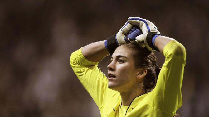U.S. goalkeeper Solo reacts after being defeated in a penalty shootout against Japan during their Women's World Cup final soccer match in Frankfurt in this file photo