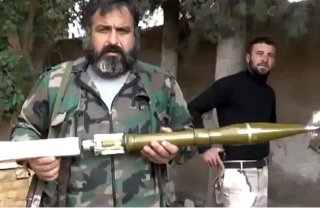 In this image taken from video obtained from the Ugarit News, which has been authenticated based on its contents and other AP reporting, the Union of Syria's Victory Battalions prepare a rocket in Ale
