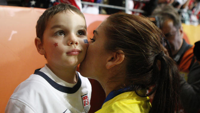 United States goalkeeper Hope Solo kisses her nephew Johnny after losing the penalty shootout of the final match between Japan and the United States at the Women's Soccer World Cup in Frankfurt, Germany, Sunday, July 17, 2011.  The Japanese women's soccer team won their first World Cup Sunday after defeating USA in a penalty shoot-out.(AP Photo/Michael Probst)