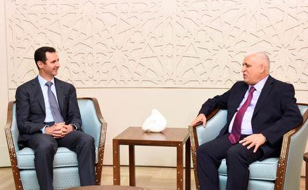 Syria's President Bashar al-Assad meets Faleh al-Fayad, the Iraqi National Security Advisor and envoy of the Iraqi Prime Minister Haider al-Abadi, in Damascus