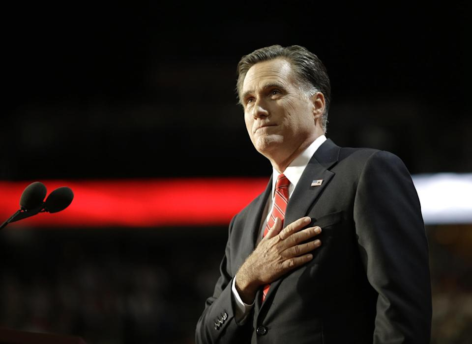 Republican presidential nominee Mitt Romney acknowledges delegates before speaking at the Republican National Convention in Tampa, Fla., on Thursday, Aug. 30, 2012.  (AP Photo/Charles Dharapak)