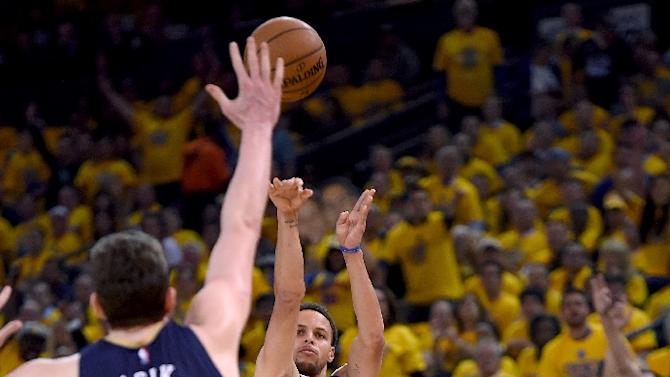 Golden State Warriors' Stephen Curry shoots over New Orleans Pelicans' Omer Asik during the first round of the NBA Playoffs at ORACLE Arena on April 20, 2015