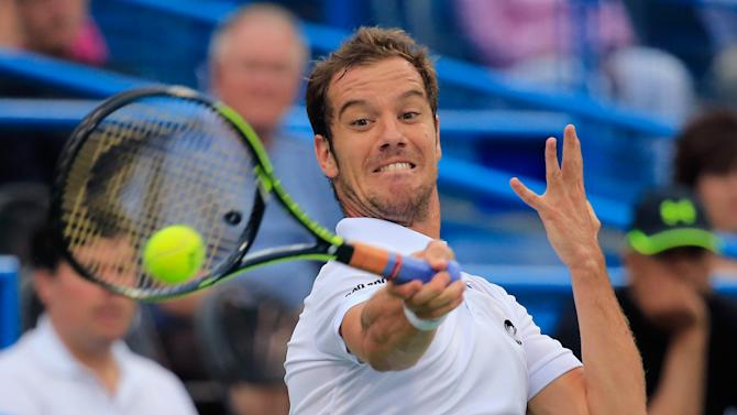 Richard Gasquet of France returns a shot to Kei Nishikori of Japan during the Citi Open at the William H.G. FitzGerald Tennis Center on August 1, 2014 in Washington, DC