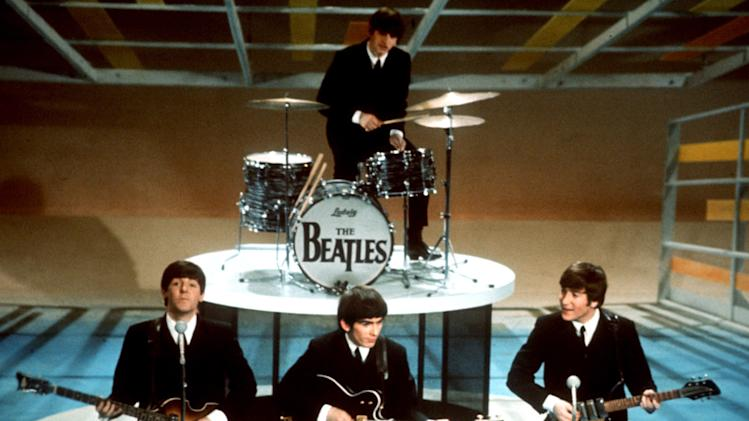 """FILE - In this Feb. 9, 1964 file photo, The Beatles, clockwise from top, Ringo Starr, John Lennon, George Harrison and Paul McCartney, perform on CBS' """"Ed Sullivan Show"""" in New York. CBS is planning a two-hour special on Feb. 9, 2014, to mark the 50th anniversary of the Beatles' groundbreaking first appearance on """"The Ed Sullivan Show."""" (AP Photo, file)"""