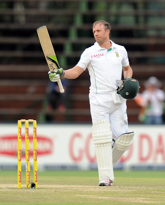 South Africa's batsman AB de Villiers celebrates his century on the 5th day of the first cricket Test match between South Africa and India at Wanderers Stadium in Johannesburg on December 22, 2013