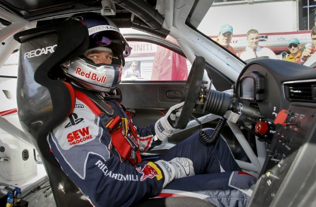 France's driver Loeb looks on from inside his car before the qualifying session of the Porsche Supercup in Monaco