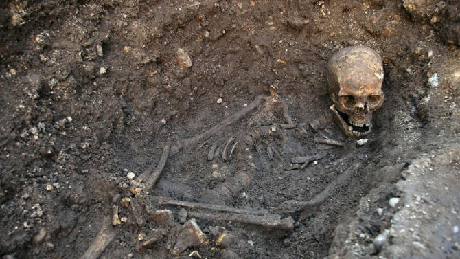 """Undated photo made available by the University of Leicester, England, Monday Feb. 4 2013  of the remains  found underneath a car park last September at the Grey Friars excavation in Leicester, which have been declared Monday  """"beyond reasonable doubt"""" to be the long lost remains of England's King Richard III, missing for 500 years.  Richard was immortalized in a play by  Shakespeare as a hunchbacked usurper who left a trail of bodies — including those of his two young nephews, murdered in the Tower of London — on his way to the throne. (AP Photo/ University of Leicester)"""