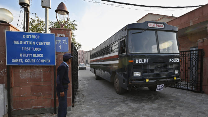 A Delhi police van, believed to be carrying the five men facing charges that they raped and murdered a 23-year-old woman aboard a moving bus in the capital last month, comes out of a district court in New Delhi, India, Monday, Jan. 21, 2013. Legal proceedings in the fatal gang-rape attack on a student in India's capital began Monday in in a new fast-track court set up to deal specifically with crimes against women that has stirred debate over how best to deliver justice to rape victims. (AP Photo/ Saurabh Das)