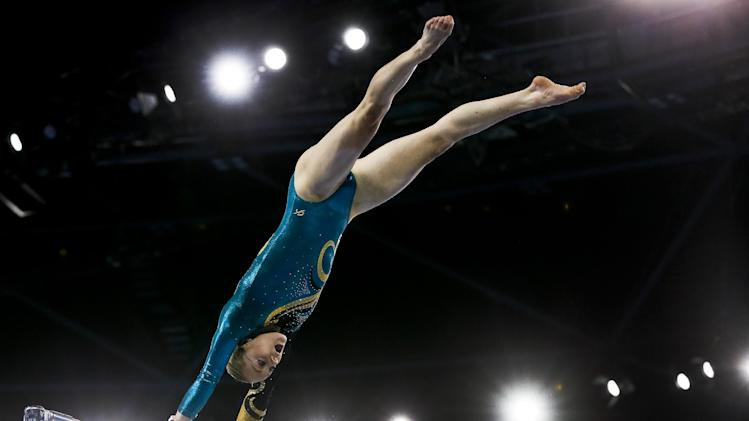 Silver medal winner Larissa Miller of Australia performs during the women's individual uneven bars final in the artistic gymnastics competition at the Scottish Exhibition Conference Centre during the Commonwealth Games 2014 in Glasgow, Scotland, Thursday July 31, 2014. (AP Photo/Kirsty Wigglesworth)