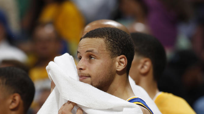 Golden State Warriors guard Stephen Curry reacts as time runs out on their 107-100 loss to the Denver Nuggets in Game 5 of their first-round NBA basketball playoff series, Tuesday, April 30, 2013, in Denver. (AP Photo/David Zalubowski)